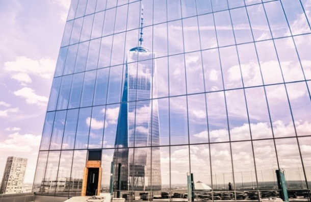 One World Trade Center reflected in the glass facade of Four World Trade Center. Vivienne Gucwa/Guardian